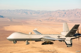 This handout photo courtesy of the US Air Force obtained on November 7, 2020 shows an MQ-9 Reaper unmanned aerial vehicle (UAV…