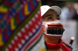 An indigenous woman takes part in a protest in demand of the resignation of Guatemalan President Alejandro Giammattei, in…