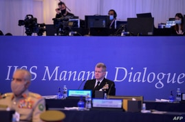 Commander of US Naval Forces, Central Command, Vice Admiral Samuel Paparo attends a session at the Manama Dialogue security…