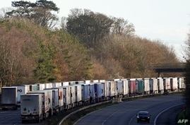 Freight lorries remain queued up on the M20 motorway, southbound, leading to the Port of Dover, at Ashsford, in south-east…