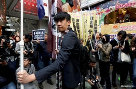 Disqualified pro-independence legislator Baggio Leung attends in an annual New Year's Day march in Hong Kong, China January 1,…