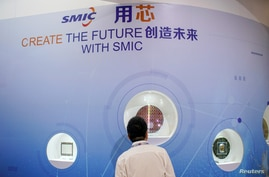 A man visits a booth of Semiconductor Manufacturing International Corporation (SMIC), at China International Semiconductor Expo (IC China 2020) following the coronavirus disease (COVID-19) outbreak in Shanghai, China Oct. 14, 2020.