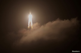 FILE PHOTO: The Long March-5 Y5 rocket, carrying the Chang'e-5 lunar probe, takes off from Wenchang Space Launch Center, in…