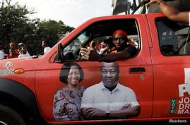 Supporter of  the opposition National Democratic Congress drives a campaign vehicle ahead of the December 7th presidential and parliamentary elections in Accra, Ghana, Nov. 21, 2020.