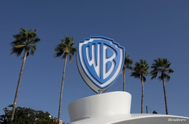 FILE PHOTO: The Warner Bros logo is seen during the annual MIPCOM television programme market in Cannes, France, October 14,…