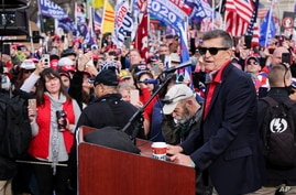 Former U.S. national security adviser Michael Flynn speaks as supporters of U.S. President Donald Trump listen during a rally to protest the results of the election in front of Supreme Court building, in Washington, U.S., Dec. 12, 2020.