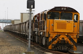 FILE PHOTO: An empty coal train sits on the tracks at the Port of Brisbane January 15, 2011. Flooding in Queensland has brought…