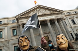 People protest against a law to legalise euthanasia as Spanish Parliament prepares to vote on it, outside the Spanish…