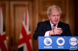 Britain's Prime Minister Boris Johnson speaks during a news conference in response to the ongoing situation with the coronavirus disease (COVID-19) pandemic, inside 10 Downing Street, London ,Britain, Dec. 19, 2020.