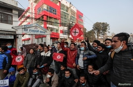 People take part in a protest after the parliament was dissolved and general elections were announced to be held in April and…