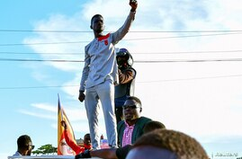 FILE PHOTO: Ugandan pop star and presidential candidate Robert Kyagulanyi, also known as Bobi Wine, campaigns near Kampala,…