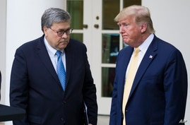 Attorney General William Barr, left, and President Donald Trump turn to leave after speaking about the 2020 census in the Rose…