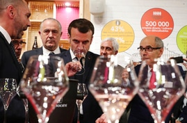 French President Emmanuel Macron drinks wine during a visit to the International Agriculture Fair (Salon de l'Agriculture) at…