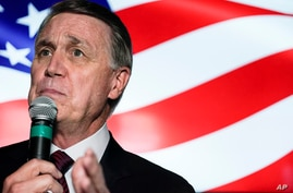 FILE - In this Friday, Nov. 13, 2020 file photo, candidate for U.S. Senate Sen. David Perdue speaks during a campaign rally, in…
