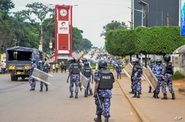 Security forces block the street leading to the Electoral Commission during a visit by Ugandan opposition presidential…