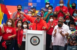 Venezuela's President Nicolas Maduro speaks to supporters during a closing campaign rally for the upcoming National Assembly…