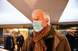 European Commission's chief negotiator Michel Barnier wears a face mask as he leaves his hotel to head back to Brussels, in London, Dec. 5, 2020.