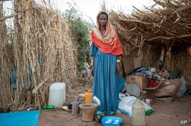 Ethiopian Tigrayan refugee 27-year-old Aksamaweet Garazgerer, who is living with HIV, stands in front of her temporary shelter.