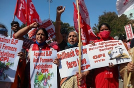 Left party supporters participate in a protest during a nationwide shutdown called by thousands of Indian farmers.