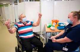 Henry (Jack) Vokes, 98, reacts receiving the Pfizer-BioNTech COVID-19 vaccine at Southmead Hospital, Bristol, England.
