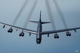 FILE - In this May 21, 2019 photo provided by the U.S. Air Force, a U.S. B-52H Stratofortress, prepares to fly over Southwest…
