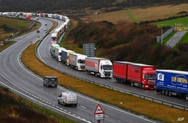 Lorries queue in Dover, England, Friday, Dec. 11, 2020. The U.K. left the EU on Jan. 31, but remains within the bloc's tariff…