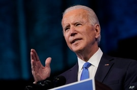 President-elect Joe Biden speaks after the Electoral College formally elected him as president, Dec. 14, 2020, at The Queen theater in Wilmington, Del.