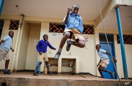 Schoolchildren joke around and play at the Olympic Primary School in Kibera, one of the capital Nairobi's poorest areas, in Kenya, Oct. 12, 2020.