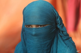Fourteen-year-old Neha sits during an interview Wednesday Nov. 11, 2020, in Karachi, Pakistan. Neha's family forced her to…