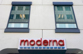 FILE - In this Dec. 15, 2020, file photo, a sign for Moderna, Inc. hangs on its headquarters in Cambridge, Mass. The U.S. is…
