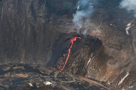 In this photo provided by the U.S. Geological Survey, an active fissure is seen in the crater of Hawaii's Kilauea volcano on…
