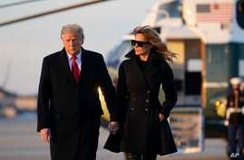 President Donald Trump and first lady Melania Trump board Air Force One at Andrews Air Force Base, Md., Dec. 23, 2020. Trump raveled to his Mar-a-Lago resort in Palm Beach, Florida.