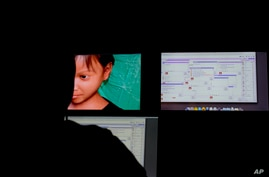 A Terre des Hommes researcher chats in a public chat room where users solicit fake 10-year-old Sweetie from the Philippines.