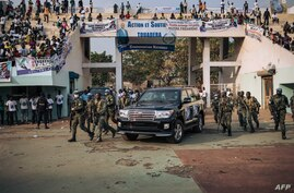 FILE - A vehicle carrying of the president of the Central African Republic, Faustin-Archange Touadera, arrives at a stadium for an election rally, in Bangui, Dec. 19, 2020.