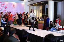 "FILE - A model showcases designer clothing at a fashion show at the Serena Hotel in Kabul, Afghanistan, Feb. 14, 2020. The Taliban has denounced a similar event held last week in the Afghan capital as a demonstration of ""obscene Western culture."""