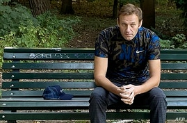 FILE - This photo posted Sept. 23, 2020, on the Instagram account of @navalny shows Russian opposition activist Alexei Navalny sitting on a bench in Berlin as he was recuperating from a poisoning attempt.