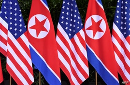 FILE - U.S. and North Korean flags stand side by side at the site of a summit between U.S. President Donald Trump and North Korea's leader Kim Jong Un, on Sentosa island in Singapore, June 12, 2018.