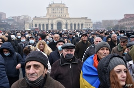 Armenian opposition supporters rally demanding the resignation of Prime Minister Nikol Pashinyan over a controversial peace deal with Azerbaijan that ended six weeks of war over the disputed region of Nagorno-Karabakh, in Yerevan, Dec. 22, 2020.