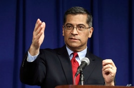 FILE - California Attorney General Xavier Becerra speaks during a news conference in Sacramento, California, March 5, 2019.