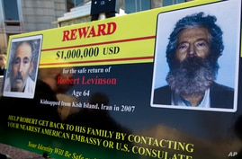 FILE - An FBI poster showing a photo and an age-progressed composite image of former FBI agent Robert Levinson, is displayed in Washington, D.C., during a news conference, March 6, 2012.