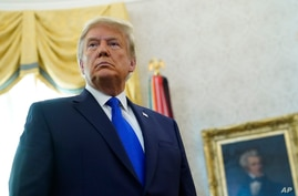 FILE - President Donald Trump listens to a reporter's question at an event in the Oval Office of the White House, in Washington, Dec. 7, 2020.