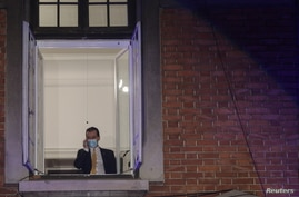 Romanian Prime Minister Ludovic Orban speaks on the phone before the announcement of the first exit polls for legislative election, in Bucharest, Romania, Dec. 6, 2020. (Inquam Photos/Octav Ganea via Reuters)