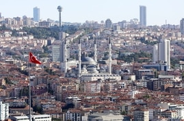 A view taken on August 9, 2019 from Ankara Castle (Ankara Kalesi) shows Kocatepe Mosque (C) and Atakule television tower (top…
