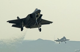 "Israeli F35 I fighter jets take part in the ""Blue Flag"" multinational air defense exercise at the Ovda air force base, north of…"