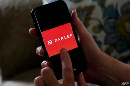This illustration picture shows social media application logo from Parler displayed on a smartphone in Arlington, Virginia on…