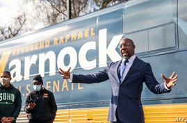 Georgia Senatorial candidate Reverend Raphael Warnock speaks to supporters at a canvassing event on January 5, 2021 in Marietta…