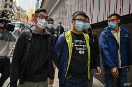 Ben Chung (front C) of a pro-democracy political group is arrested by police in the Central district