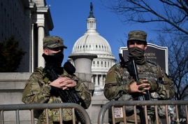 US National Guar soldiers provide security at the US Capitol in Washington, DC, January 14, 2021, ahead of next week's…