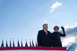 Outgoing US President Donald Trump and First Lady Melania Trump address guests at Joint Base Andrews in Maryland on January 20,…