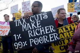 """Demonstrators against the Republican tax reform bill hold a """"People's Filibuster to Stop Tax Cuts for Billionaires,"""" protest…"""